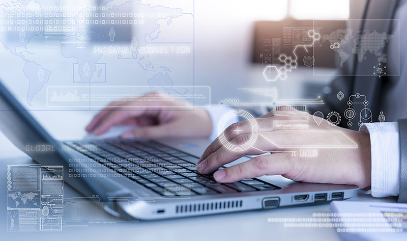 Close up of business man typing on laptop conputer with technology layer effect